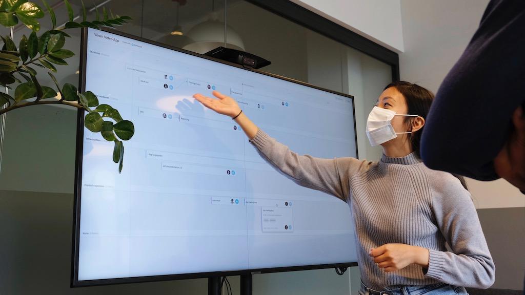 woman presenting on screen