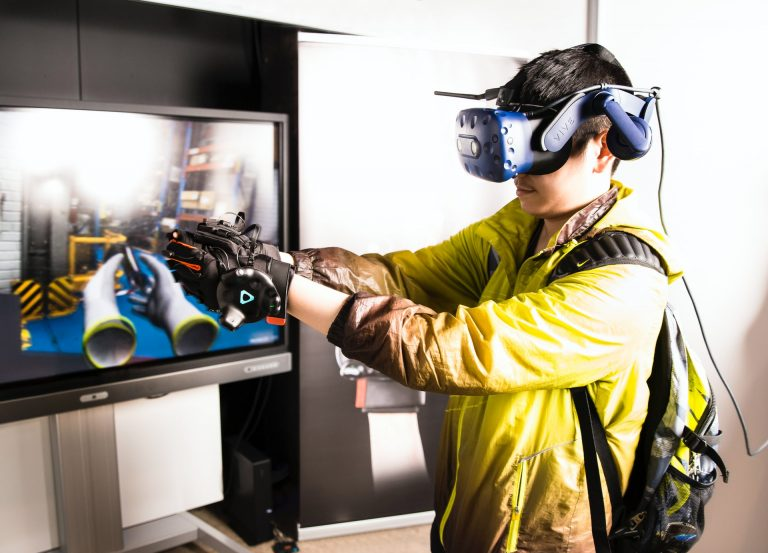 man using VR headset to train