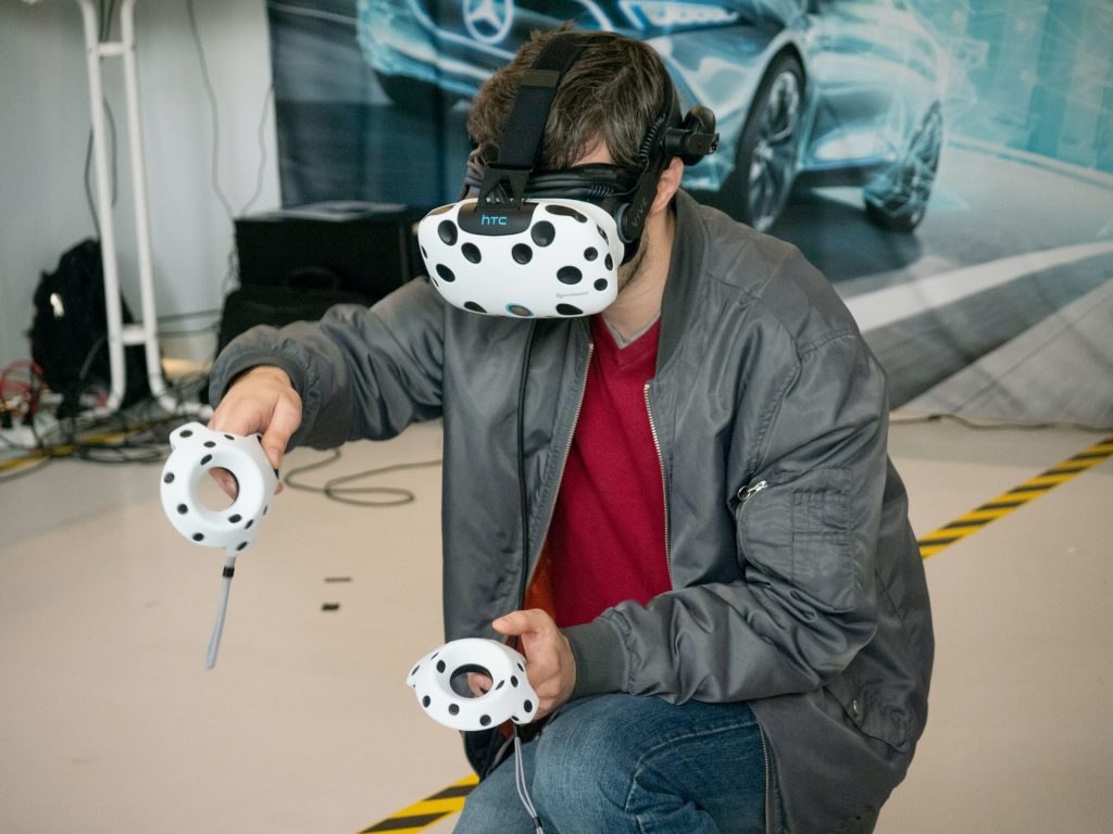 man using vr headset and controllers
